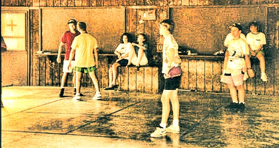Kids playing four-square on a cement court