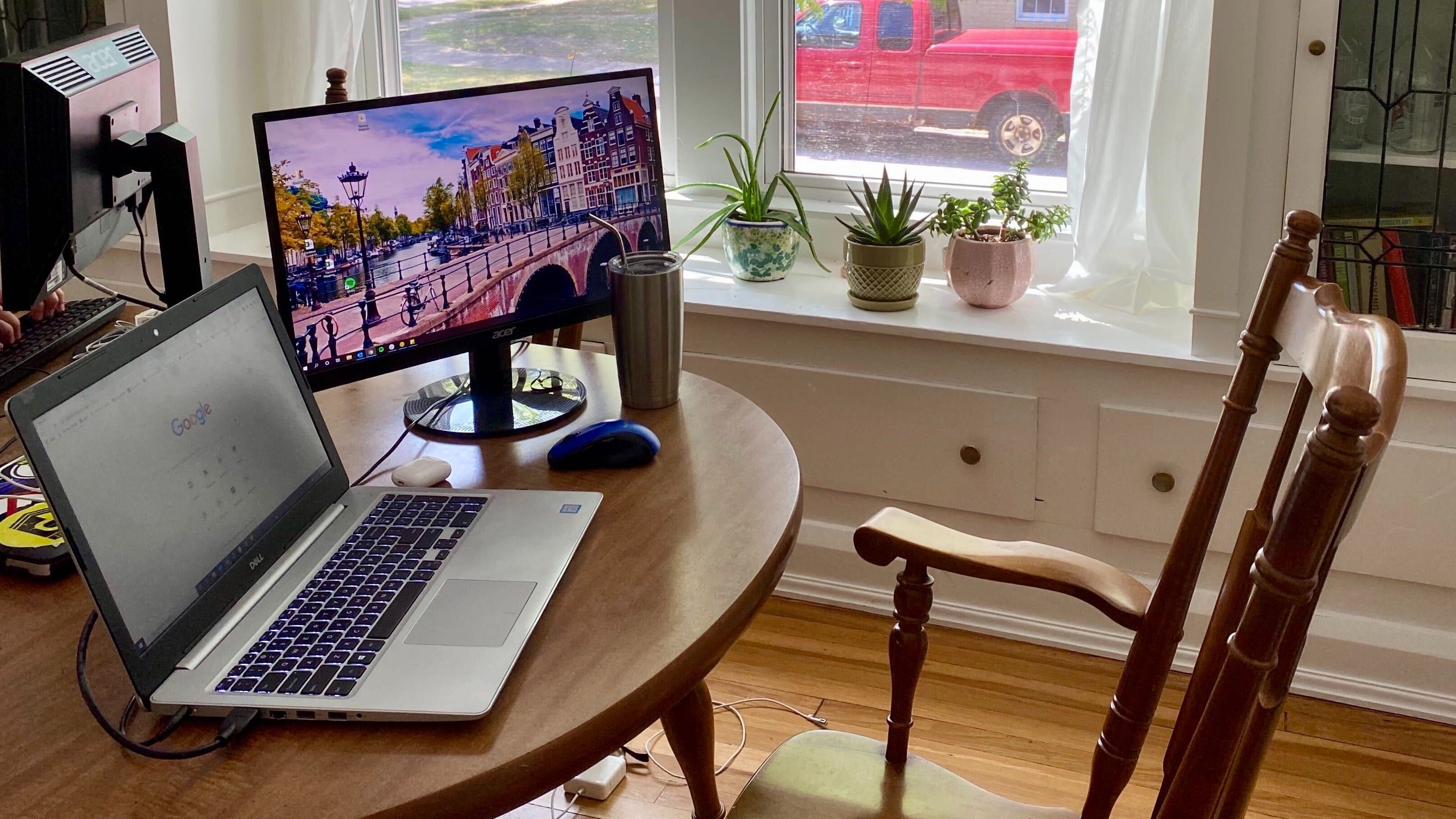 Kitchen table serves as a remote worker's desk while WFH